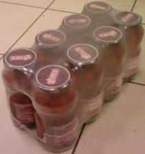 Групповая упаковка стеклянных банок с консервами