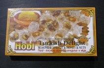 Термоусадочная упаковка коробок со сладостями